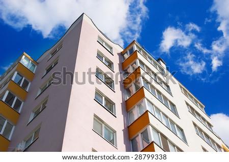 new apartment building over blue sky