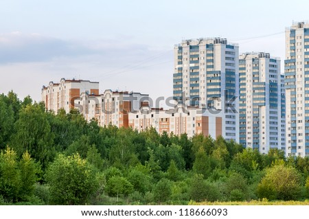 new apartment buildings in eco-friendly green belt (evening time)