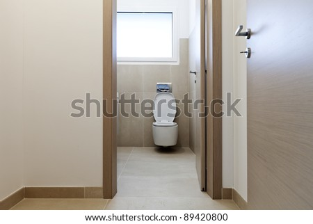 new apartment, door open, view wc - stock photo