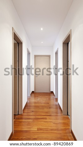 new apartment, empty corridor many doors