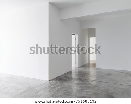 New apartment empty  living room with cement floor .