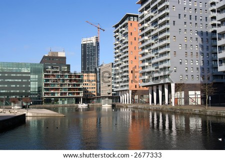 New apartment flats around a pond, office tower under construction. The Hague, Holland.