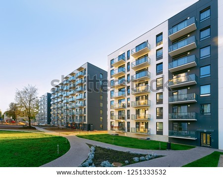 New apartment house residential building outdoor concept. Street and backgrounds.