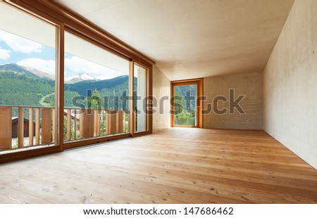 new apartment in cement and wood, empty room with windows