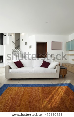 new apartment, white sofa in large living room
