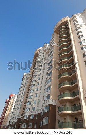 New apartments building over deep blue sky
