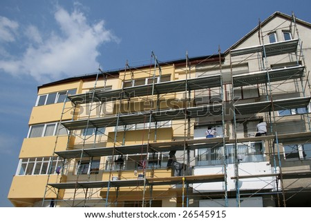 New apartments in a block with scaffolding around