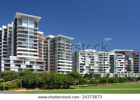 New apartments on blue background and green field