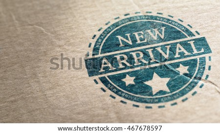 New arrival stamp over a cardboard background, horizontal image.