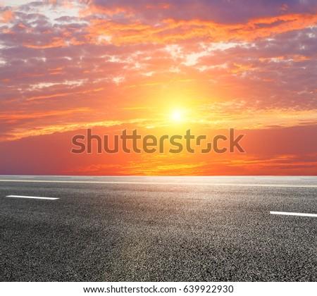New asphalt highway road at sunset #639922930