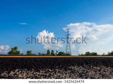 New asphalt road and electric pole on blue sky and white clouds background.Empty high way and high voltage pole in the countryside. #1425626474