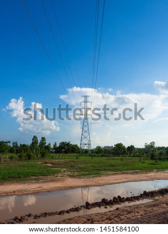 New asphalt road and electric pole on blue sky and white clouds background.Empty high way and high voltage pole in the countryside. #1451584100