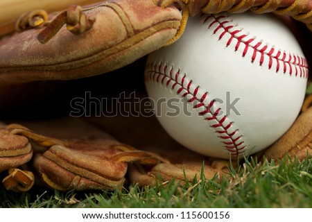 New Baseball in a Glove Close Up - stock photo