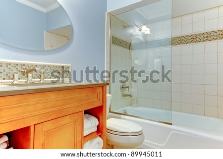 New bathroom with blue walls and white bathtub.