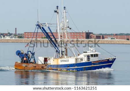New Bedford, Massachusetts, USA - August 24, 2018: Commercial fishing vessel Barbara Pauline, hailing port Cape May, New Jersey, nearing New Bedford hurricane barrier #1163621251