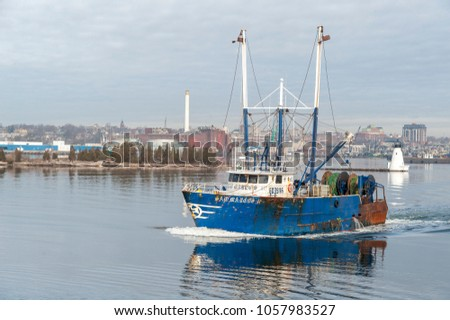 New Bedford, Massachusetts, USA - March 29, 2018: Trawler San Marcos II leaving New Bedford on calm morning #1057983527