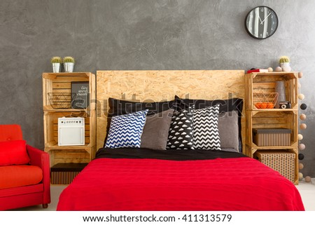 New bedroom with handmade, wood regales, big bed and red bedding