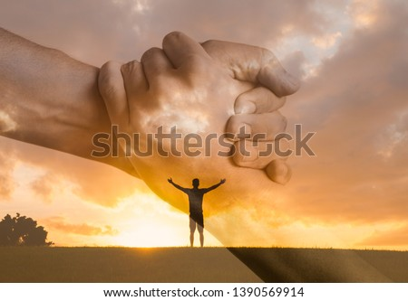 New beginnings and new start. Happy man with open arms facing the sunset. People reaching out for help. Lending a helping hand, and religious concept