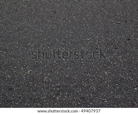 New Black Asphalt Texture. Asphalt Background with Space for Text.