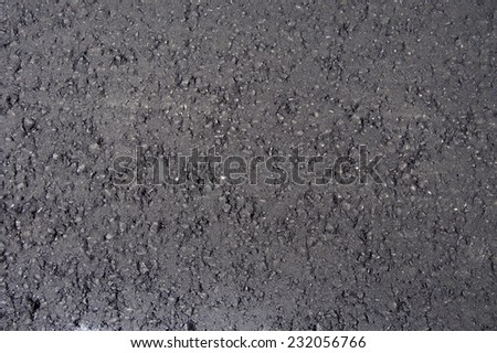 New black fresh asphalt road surface layer- Road Construction Repair