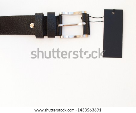 new black leather men's belt on a white background with a black label #1433563691