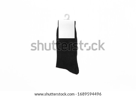 New Black socks on a white background. Black Socks Mock-up with a blank label. High resolution photo.