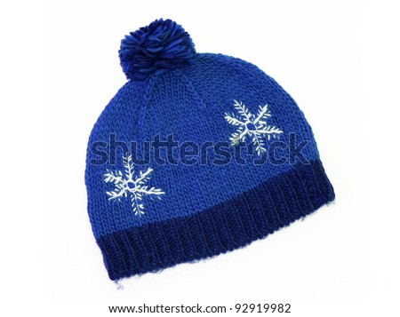 New Blue Knit Wool Hat with Pom Pom isolated on white background