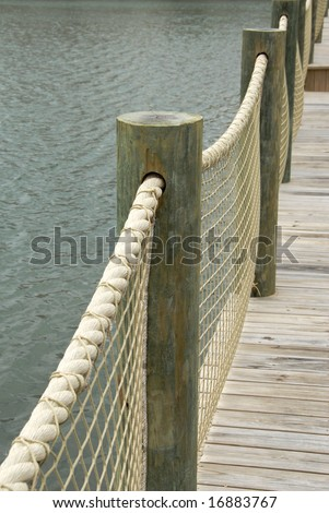 Nautical Deck Railing http://www.shutterstock.com/pic-16883767/stock-photo-new-boardwalk-with-rope-railing.html