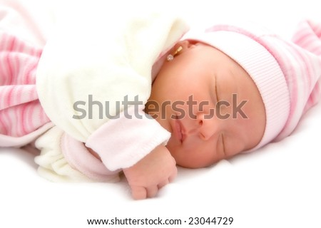 New born baby girl peacefully sleeping.