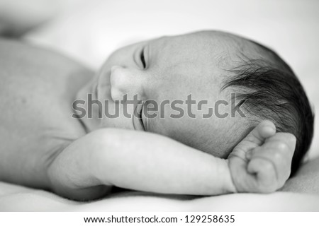 New born baby sleeping in her bed