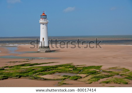 New Brighton Lighthouse. Built in the 1800's, the lighthouse overlooks the River Mersey on a summer day