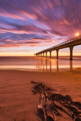 New Brighton Pier in Christchurch, New Zealand at sunrise.