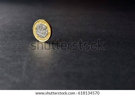 New british one sterling pound coin on dark background #618134570