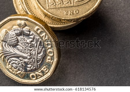 New british one sterling pound coin on dark background #618134576
