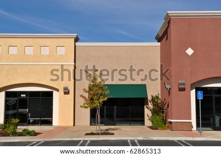 New Brown and Yellow Shopping Center Store Front #62865313