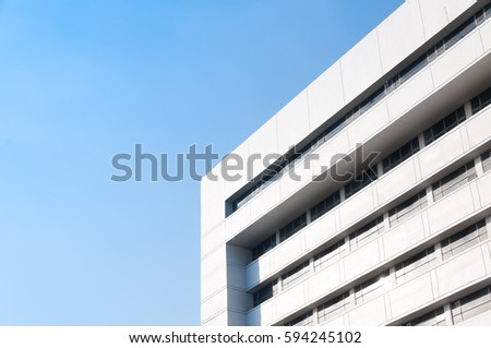 New building architecture on blue sky background,Low angle architectural exterior view of modern #594245102