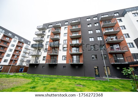New building, architecture, tenement house. Real estate photo.