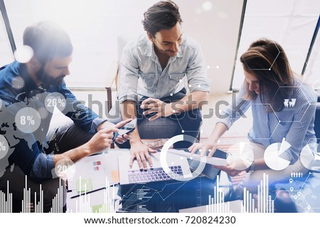 New business project startup.Group of young coworkers discussing ideas in modern office.Concept of digital diagram,graph interfaces,virtual screen,connections icon on blurred background.Top view #720824230
