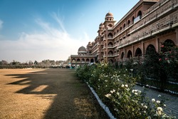 New campus of university of Peshawar, Pakistan. Build in historic architectural style. Shadow of the building casting on the ground outlines the architecture.