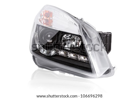 new car headlights on a white background - stock photo