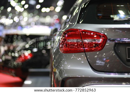 New car on show background bokeh