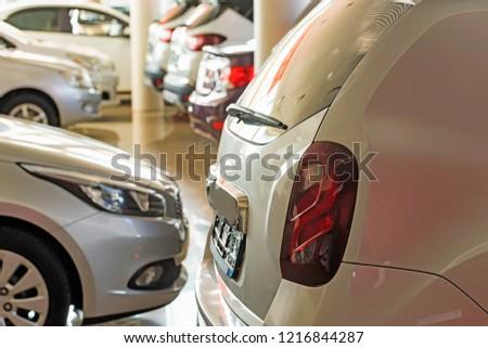 New cars at dealer showroom blurred background interior #1216844287