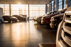 New cars at sunlit dealer showroom close view