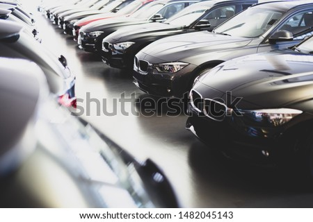 new cars in a row at the dealership #1482045143