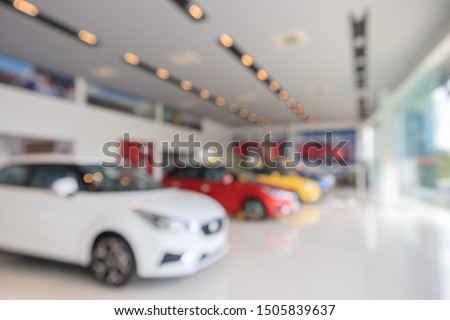 new cars in showroom blurred defocused background