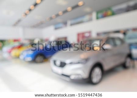 new cars in showroom blurred defocused background #1519447436