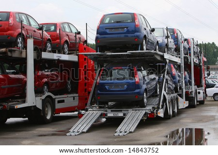 new cars on automobile transporter, truck - stock photo