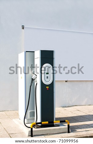 New charging station for electric car with a white canvas panel for outdoor advertising