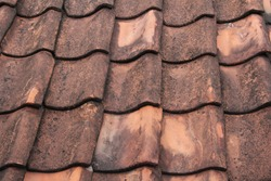 new clay tile which is starting to erode due to the rain and heat of the sun