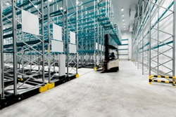 New cold room storage. Refrigeration and freezing warehouse with stacker truck inside moving.